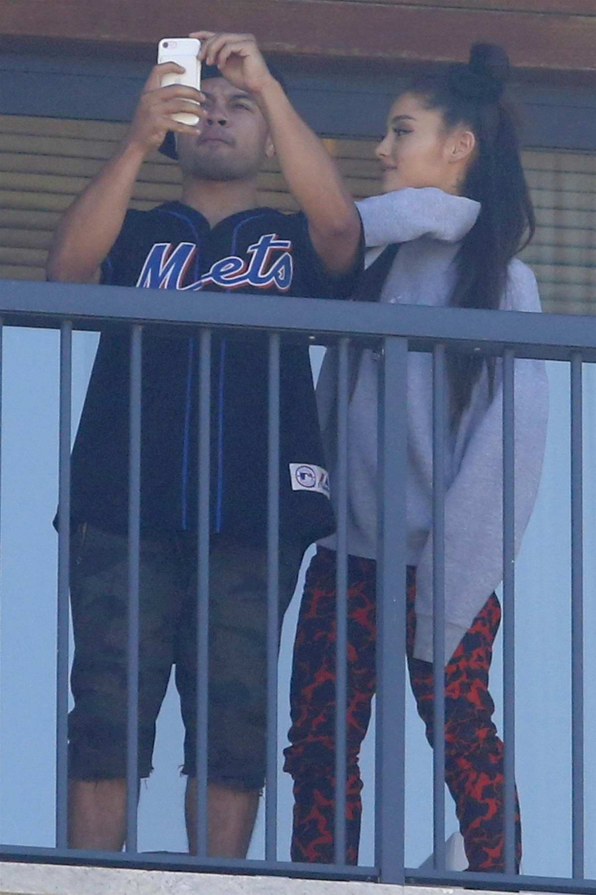 Ariana Grande and a Friend hang out on the balcony of the Grand Hyatt in Rio de Jeneiro, Brazil