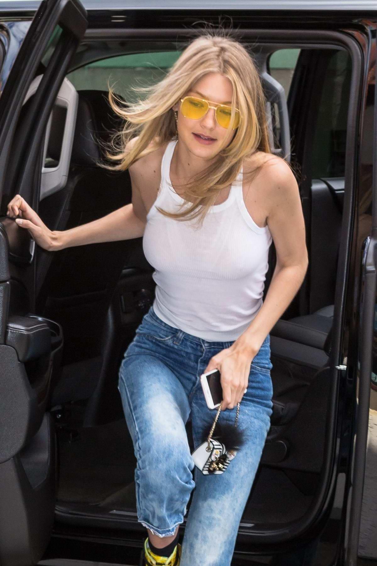 8d8d6eea41b3bd gigi hadid in a white tank top and jeans leaving a hair salon new ...