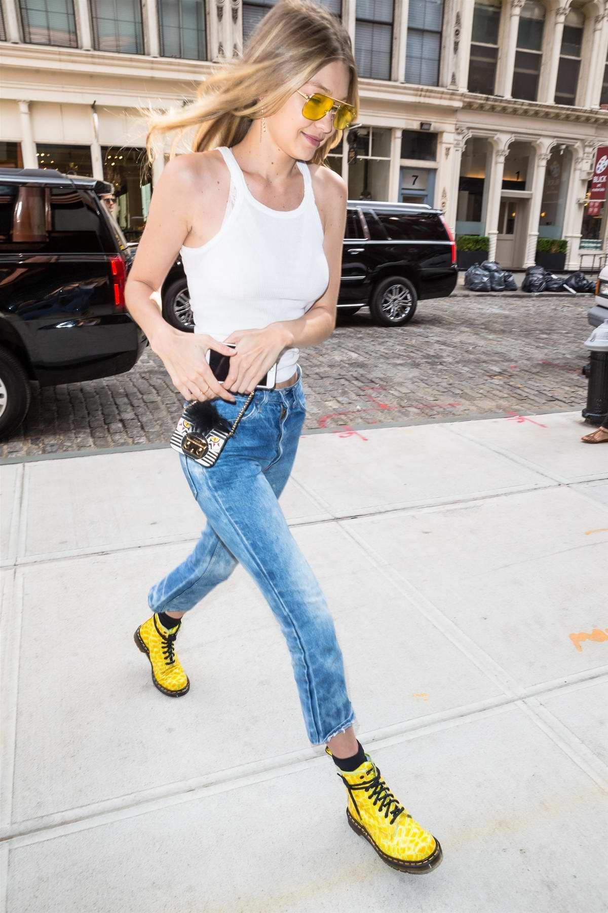 202d18c3 gigi hadid in a white tank top and jeans leaving a hair salon new  york-260617_7