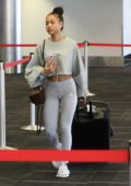 Karrueche Tran in Grey Workout Gear as she catches a flight out of Los Angeles