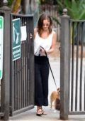 Minka Kelly out walking her Dogs in the Park in Los Angeles