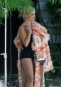 Reese Witherspoon in a Black Swimsuit with Orange and White fur Coat on the set of a Photoshoot in Los Angeles