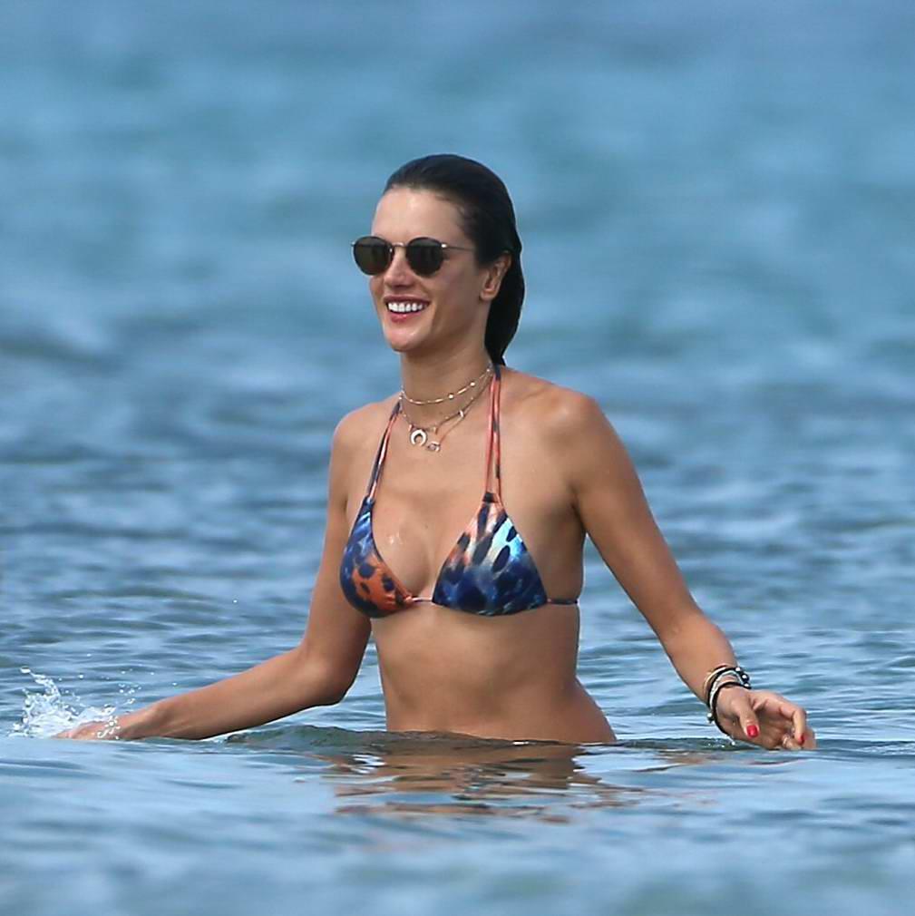 alessandra-ambrosio-in-a-colourful-print-bikini-on-the-beach-with-her-husband-in-ibiza-080717_1.jpg