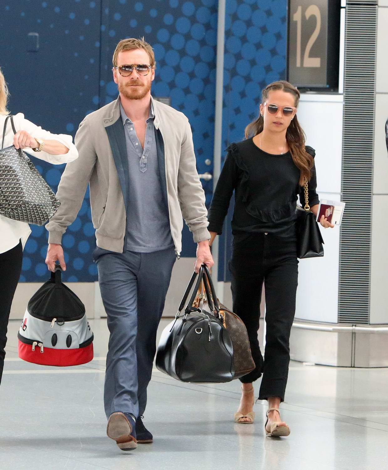 Alicia Vikander and Michael Fassbender departing from Toronto Pearson International Airport in Toronto, Canada