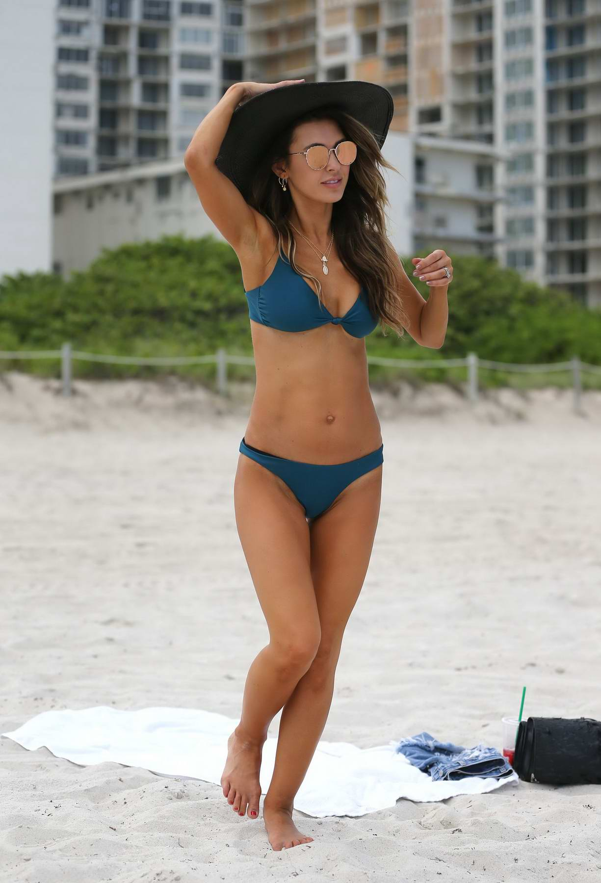 Audrina Patridge in a Blue Bikini relaxing at the Beach in Miami