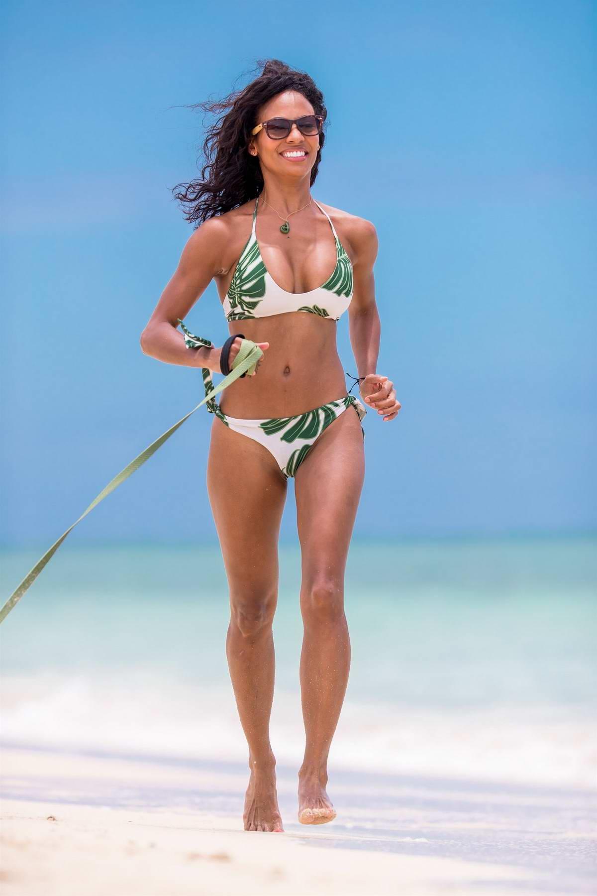Candace Smith in a Bikini enjoying a day on the Lanikai Beach with her Dog in Hawaii
