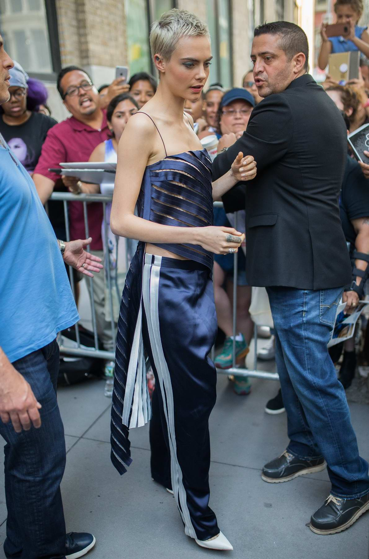 Cara Delevingne arrives the Apple Store in Soho to promote Valerian and the City of a Thousand Planets