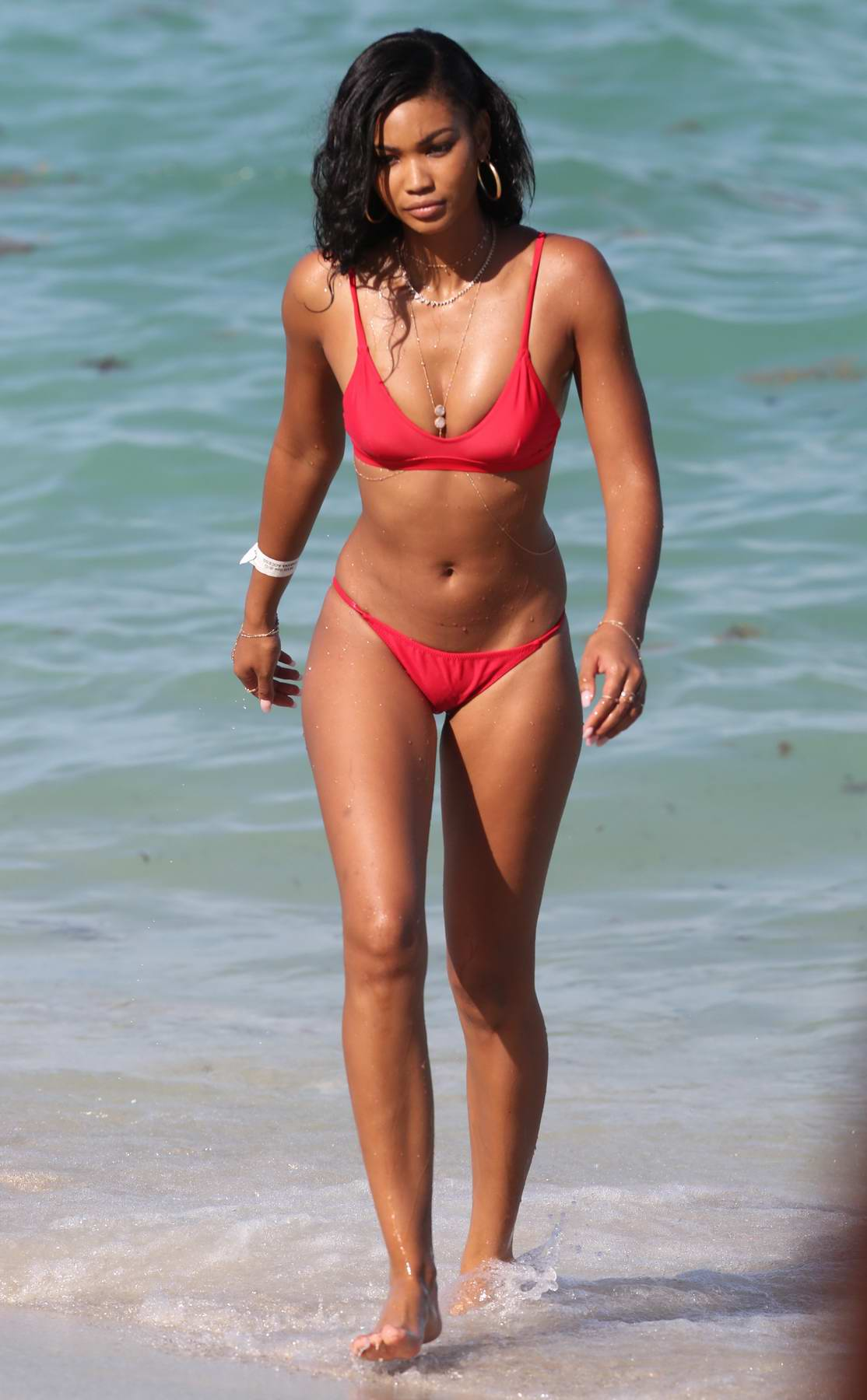 Chanel Iman in a Red Bikini enjoying the Beach with Friends in Miami