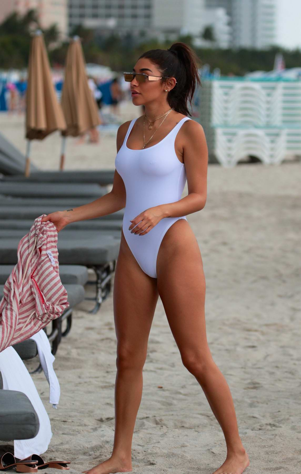 Chantel Jeffries in a White Swimsuit spends some time on the Beach in Miami