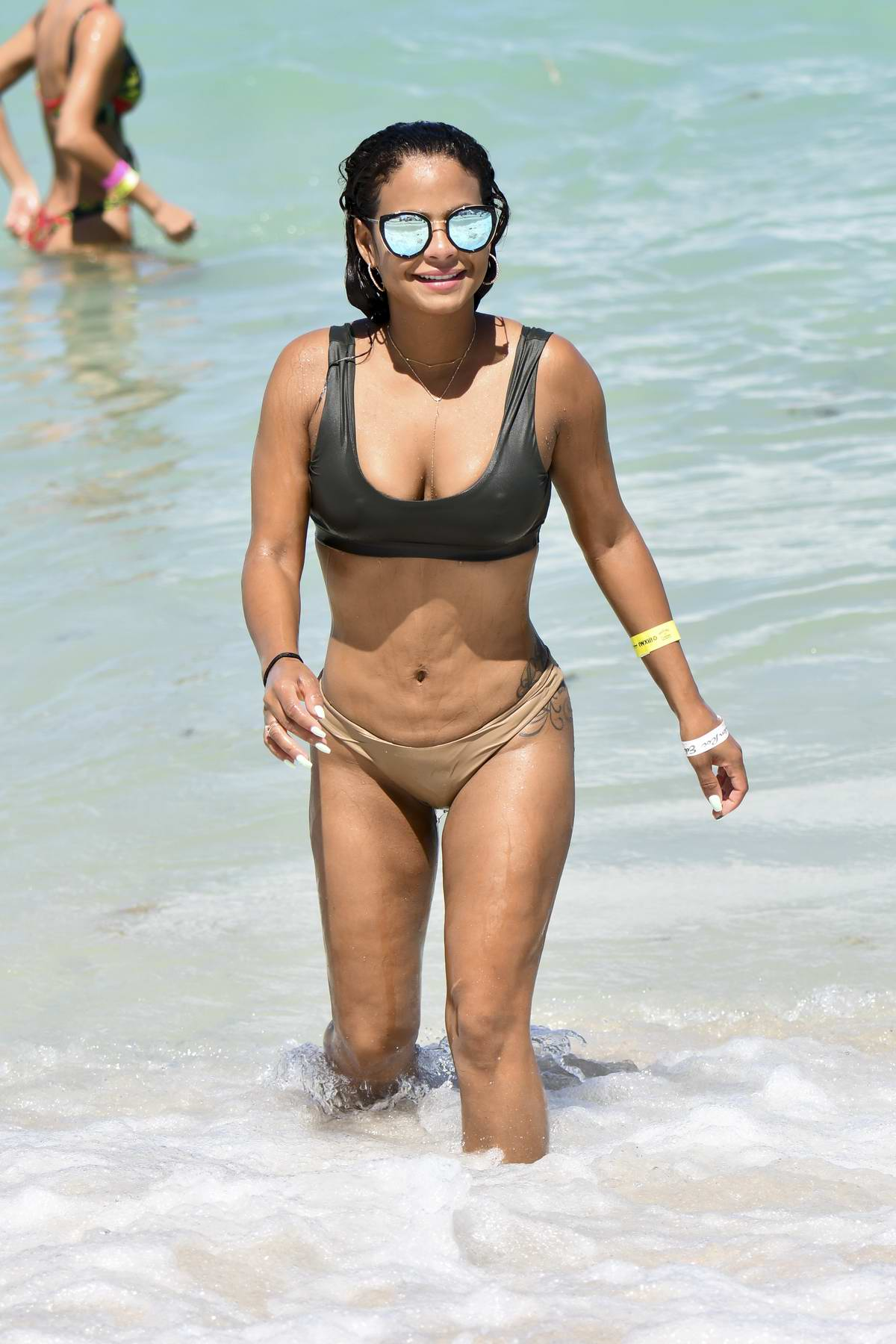 Christina Milian in Bikini enjoying the Beach in Miami