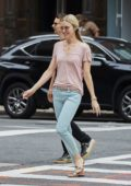 Elle Evans and boyfriend Matthew Bellamy seen checking out from there Hotel in New York