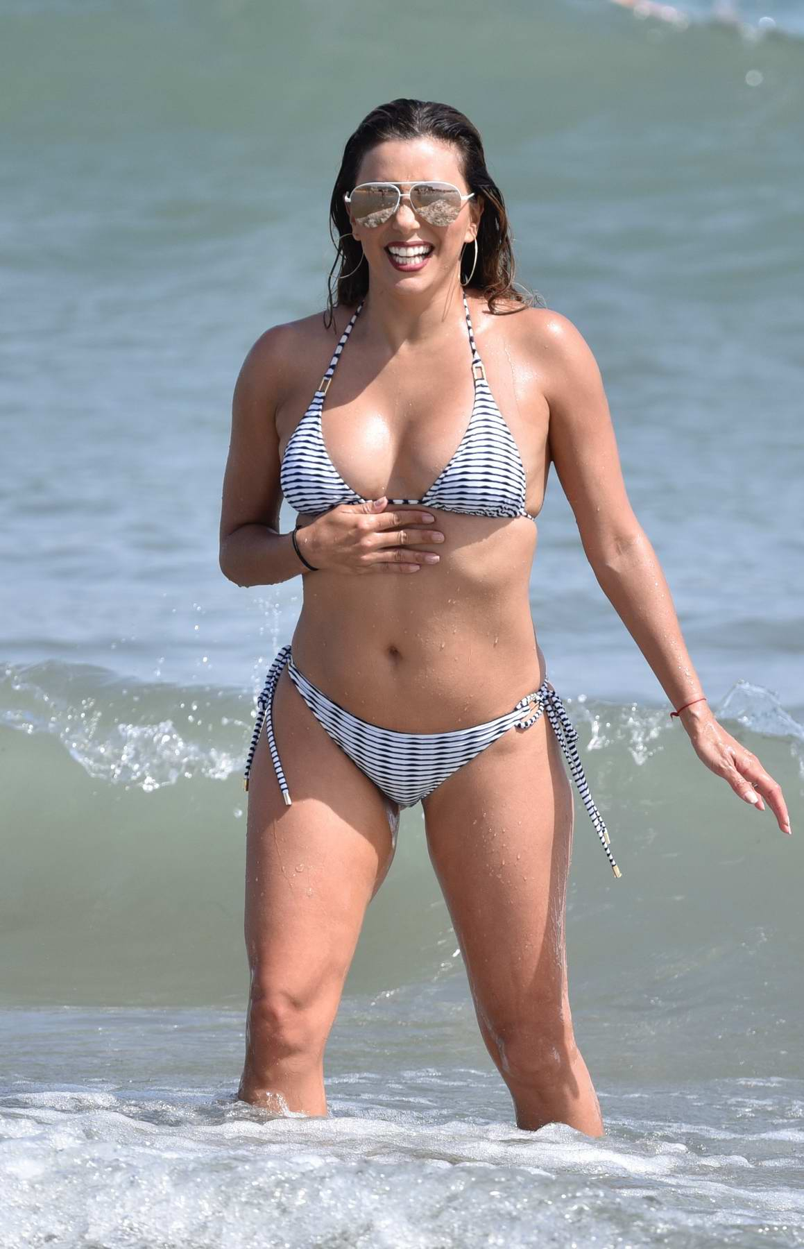 Eva Longoria in a Bikini enjoys the Beach with her Husband and Friends in Marbella, Spain