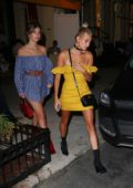 Hailey Baldwin in a Yellow Dress leaving Cipriani's Restaurant with some Friends in New York
