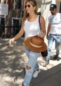 Jennifer Aniston dressed in a White Tank Top and Ripped Jeans spotted leaving her Apartment in New York