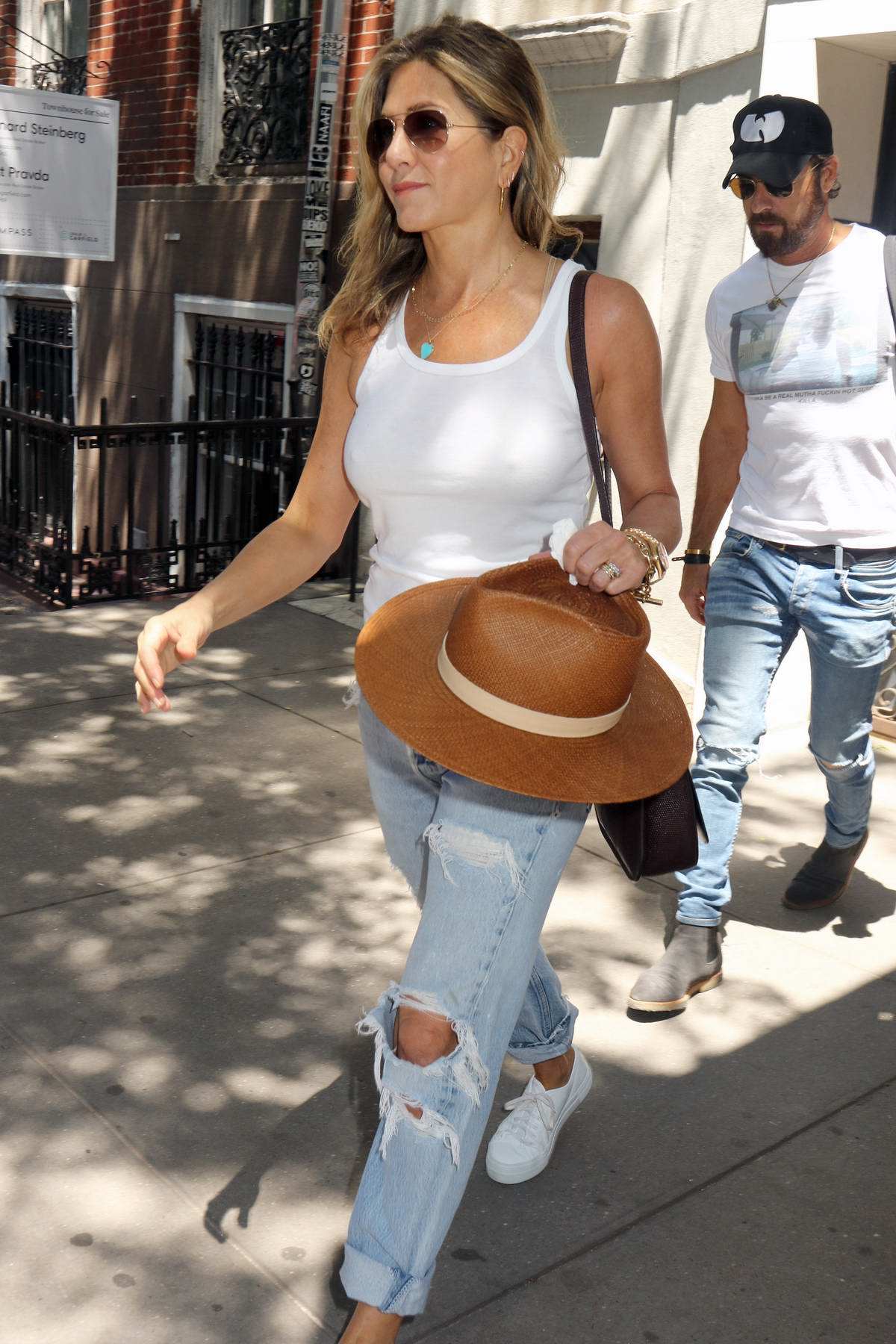 Jennifer Aniston Dressed In A White Tank Top And Ripped Jeans Spotted Leaving Her Apartment New York