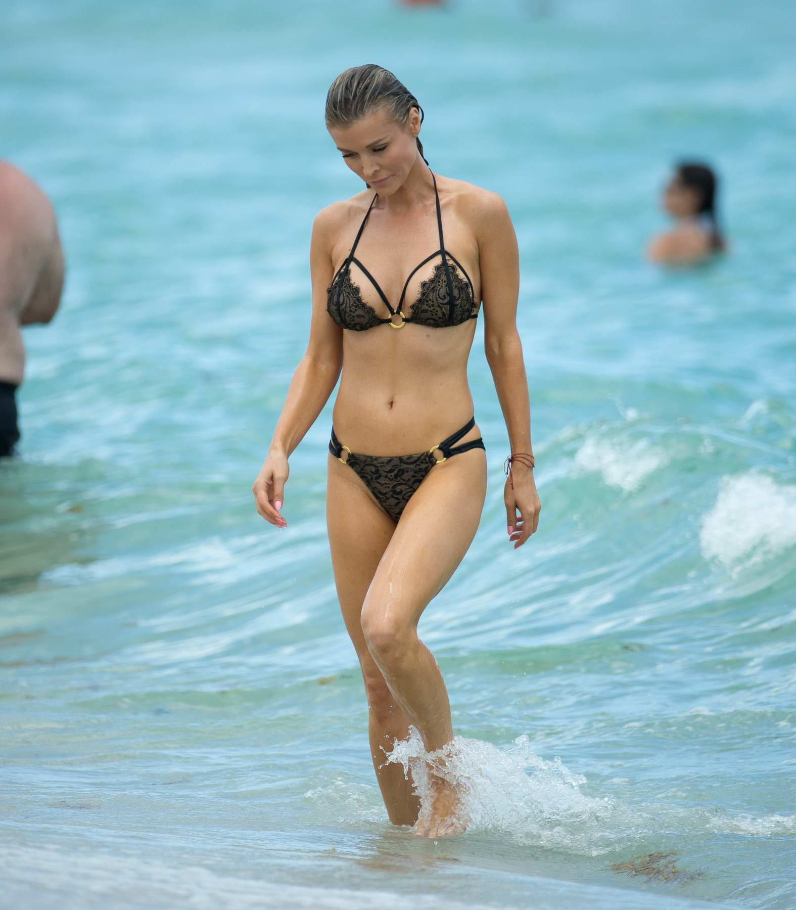 Joanna Krupa in Bikini with her Husband on the Miami Beach just a day after they filed for Divorce