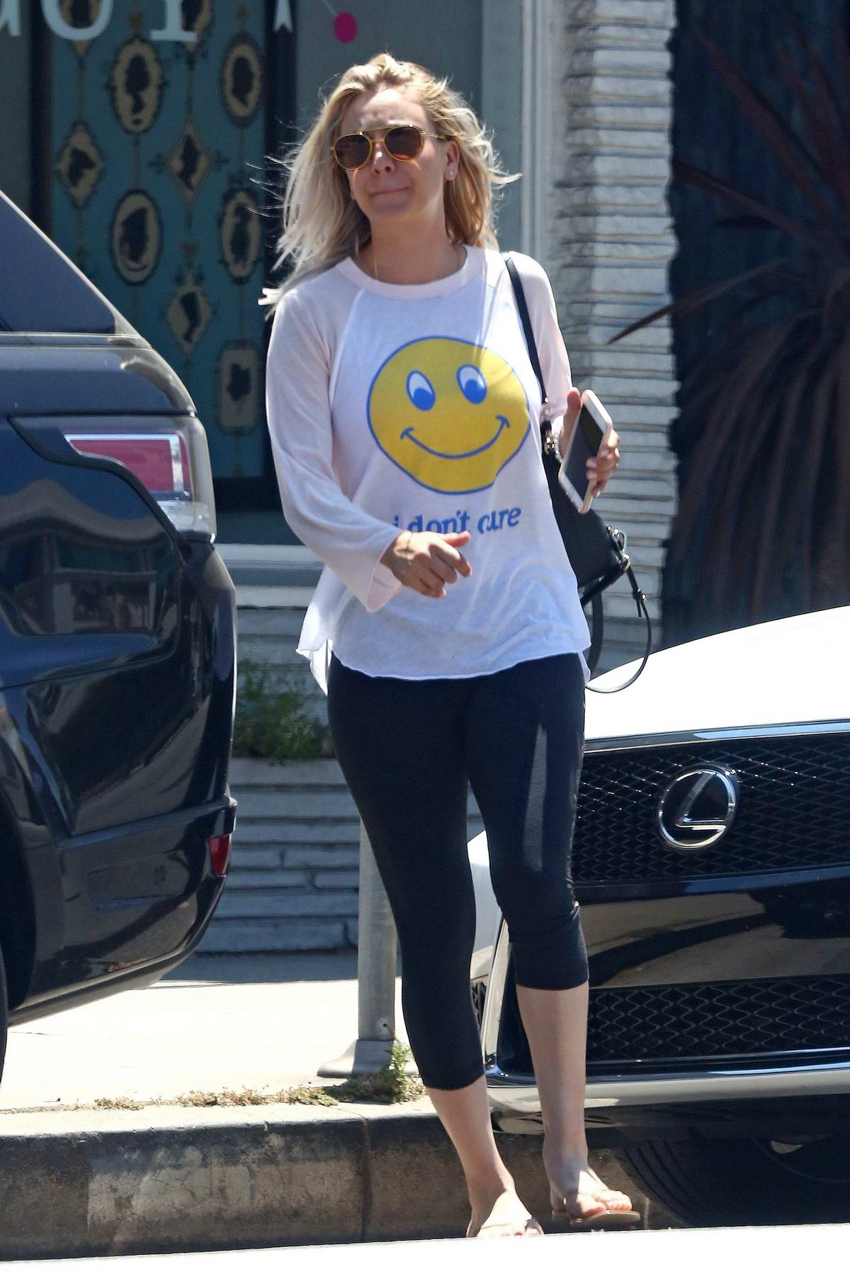 Kaley Cuoco in a Smiley Tee and Yoga Pants leaving a Nail Salon in Studio City