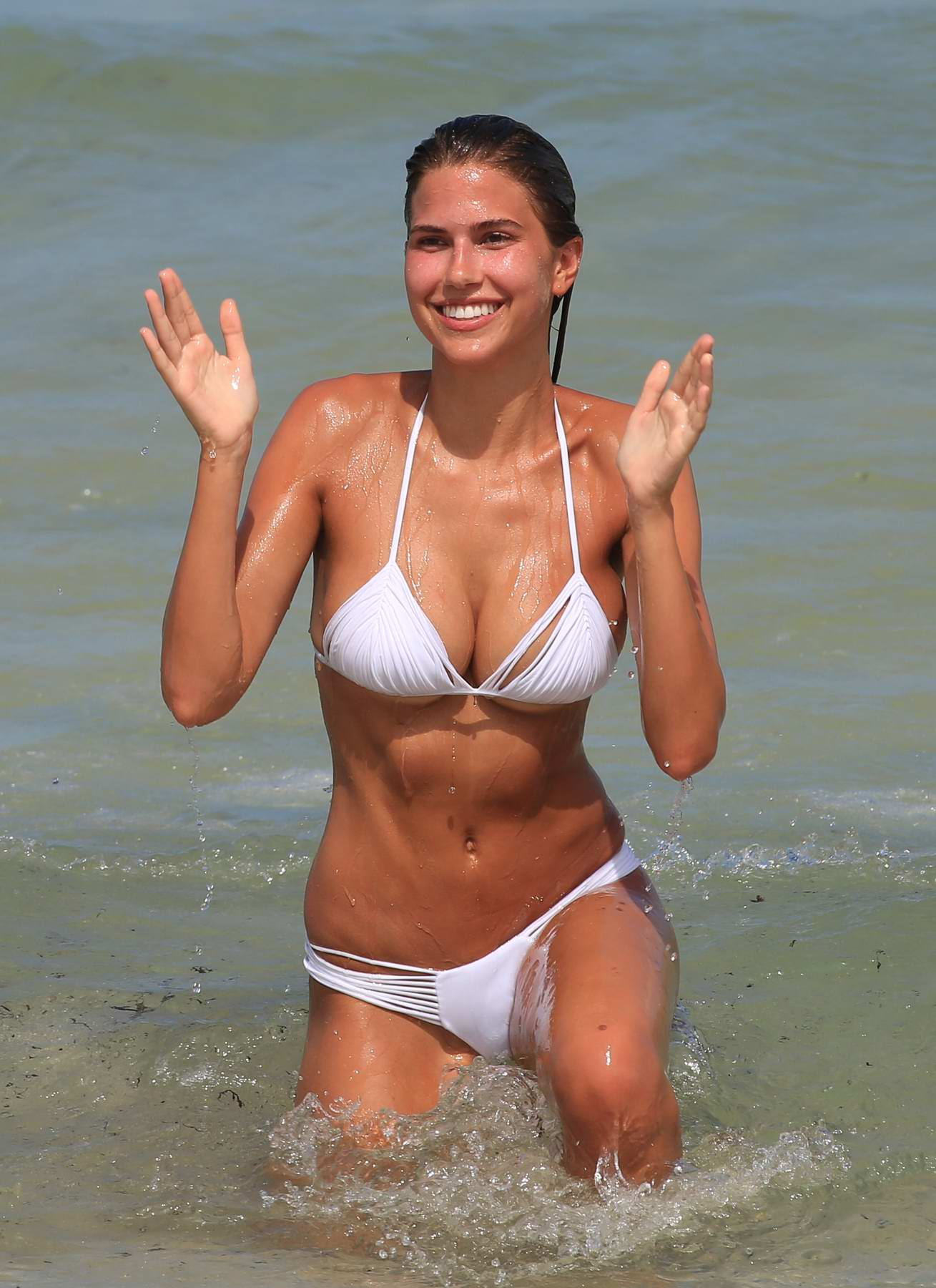 Kara Del Toro in a White Bikini enjoying the Beach in Miami