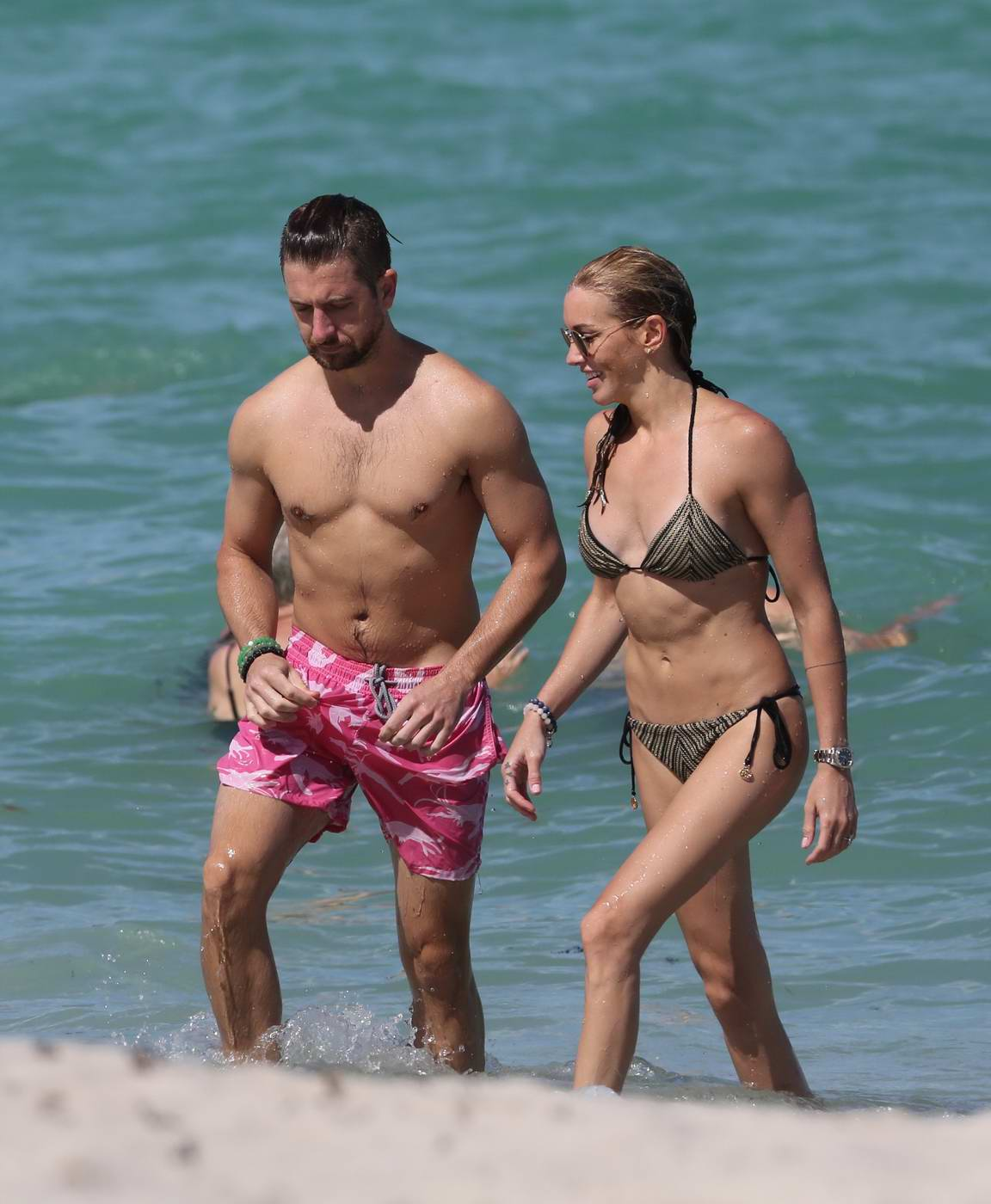 Katie Cassidy in Bikini enjoying a day off with her Boyfriend on the Beach in Miami
