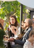 Lily Collins Dines with Friends at the Restaurant Loulou in Paris, France