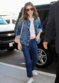 Lily Collins rocking All Denim look as she arrives at LAX Airport in Los Angeles