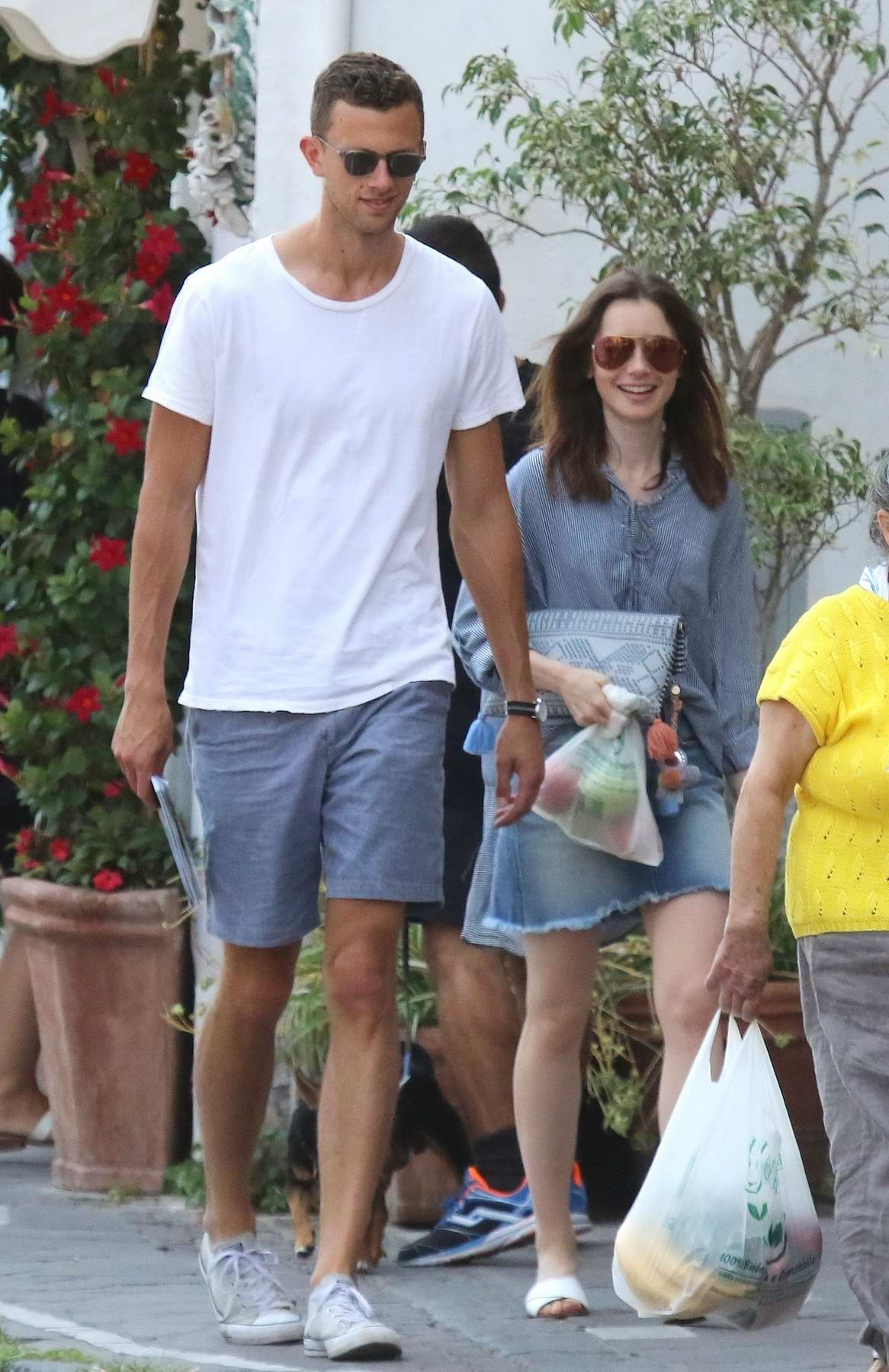 Lily Collins spotted out with a Mystery Man in Ischia, Italy