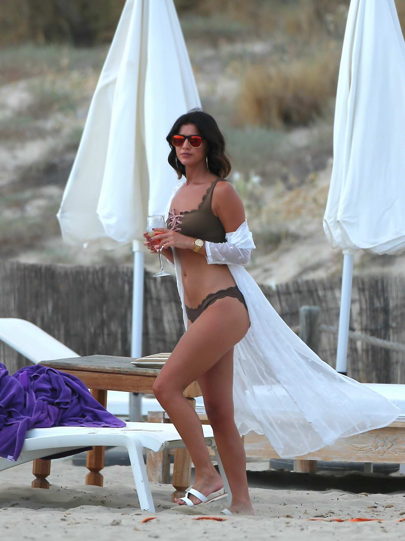 Lucy Mecklenburgh in a Bikini relaxing on the Beach while on Holiday in Ibiza, Spain