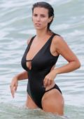 Ludivine Sagna in a Black Swimsuit enjoys the Ocean in Miami