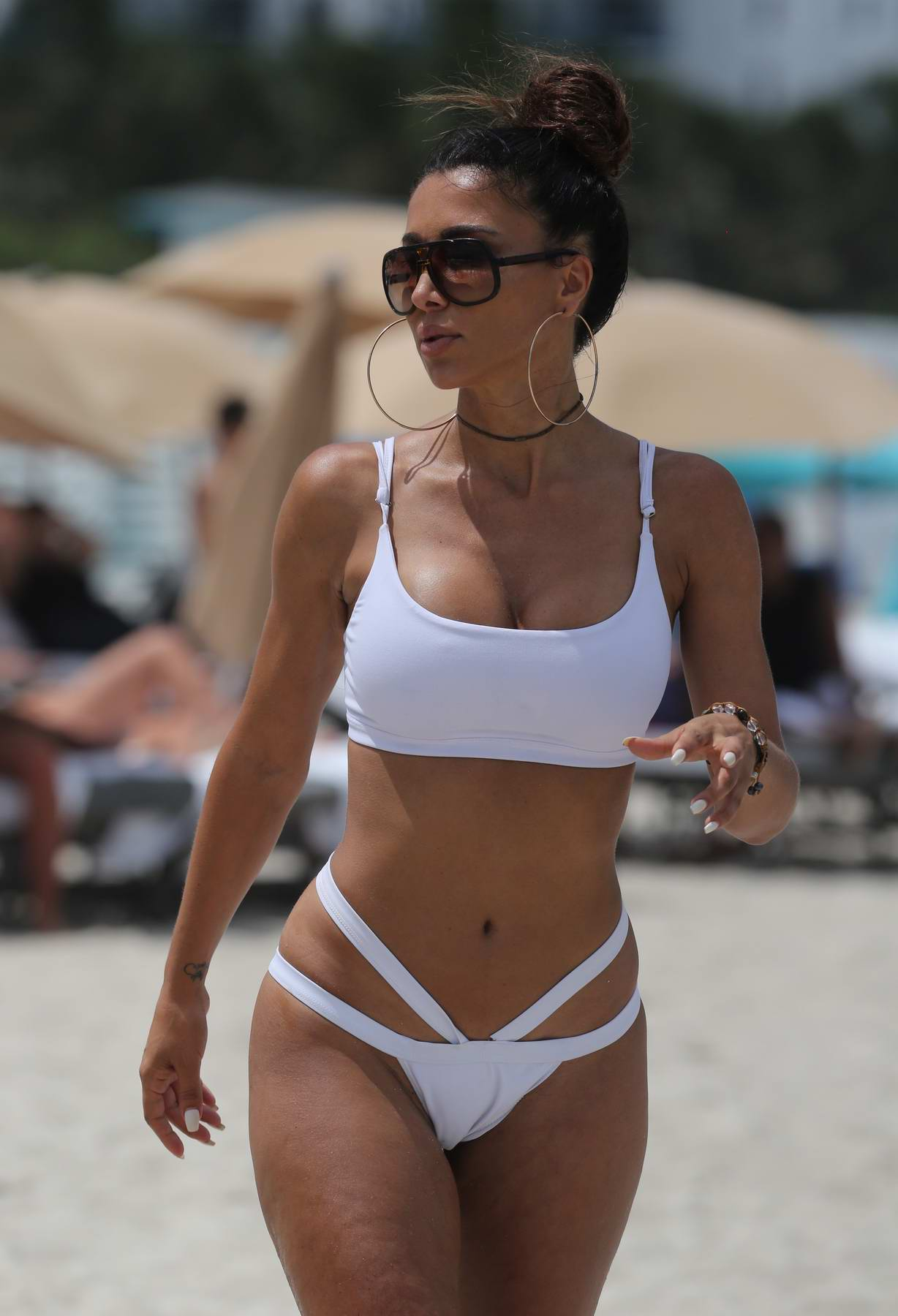 Metisha Schaefer in a White Bikini enjoys her Vacations on the Beach in Miami