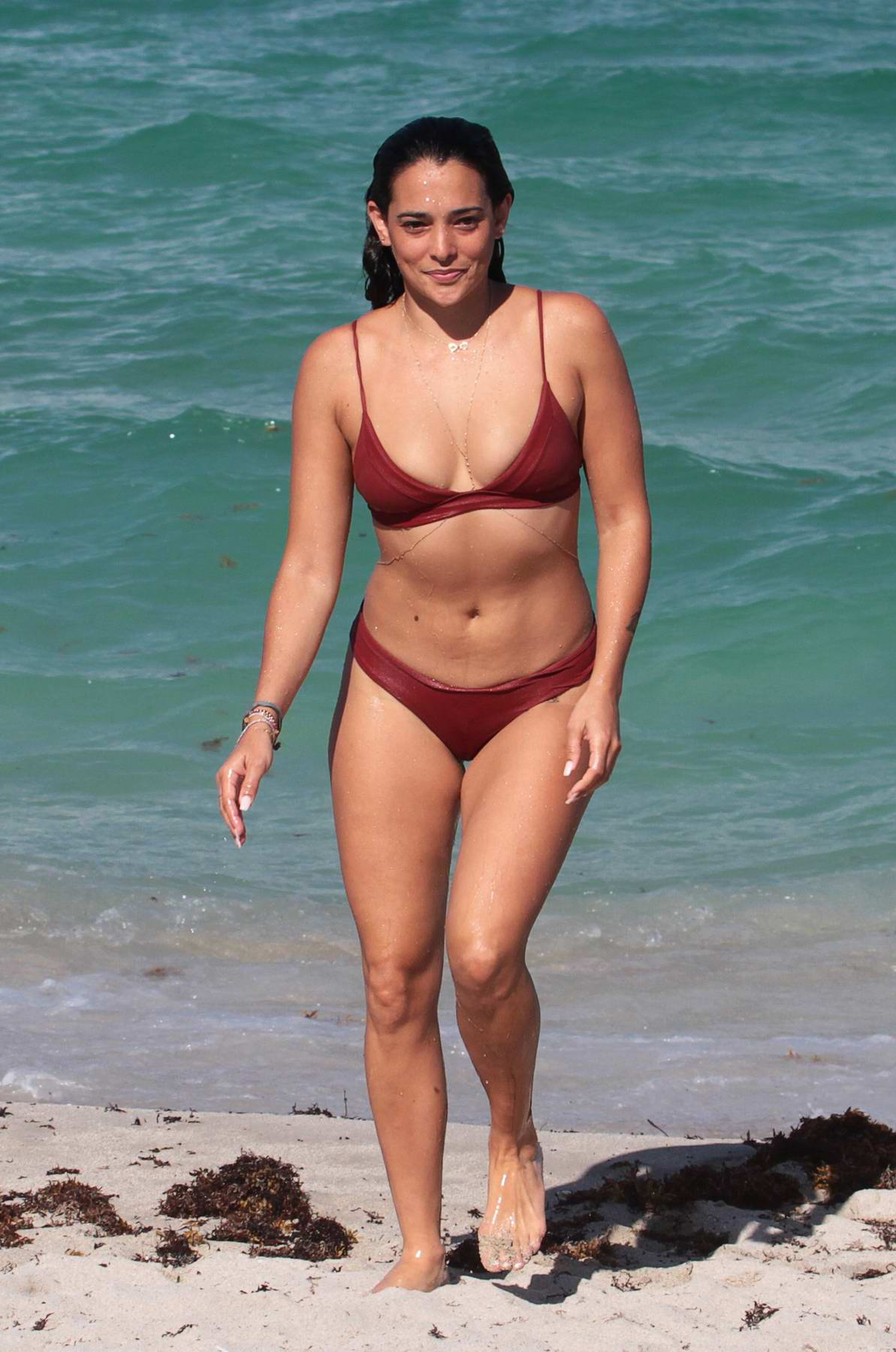 Natalie Martinez in a Bikini enjoys the Ocean and Coconut Water on the Beach in Miami