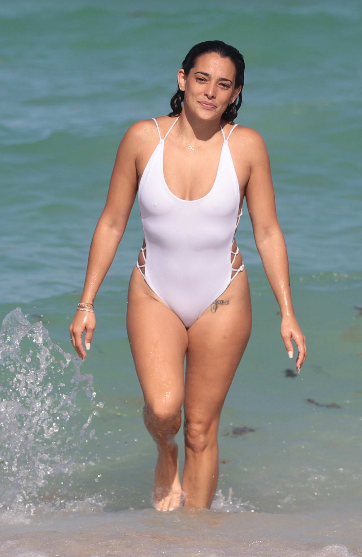 natalie-martinez-in-a-white-swimsuit-with-a-mystery-man-on-the-beach-in-miami-060717_1.jpg