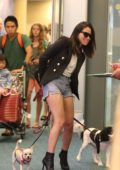 Olivia Munn in Denim Shorts arriving in Vancouver Airport with her Dogs
