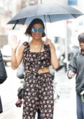 Paula Patton out in the rain with an umbrella in New York