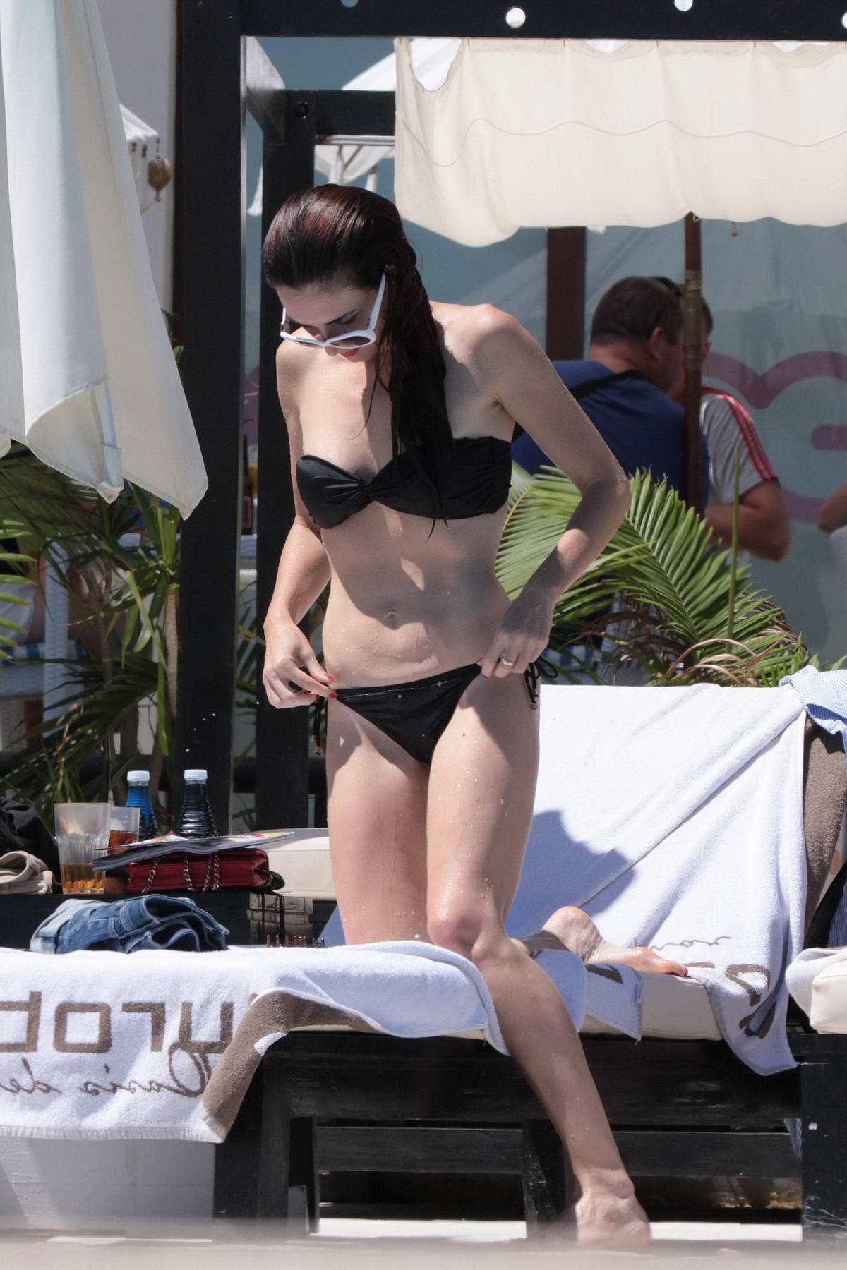 Paz Vega in a Black Bikini relaxing by the Pool in Spain