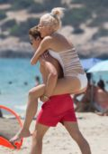 Pixie Lott in a White Swimsuit enjoying the Sea while on Holiday in Ibiza, Spain