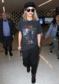 Rita Ora in Casuals arrives at LAX Airport in Los Angeles