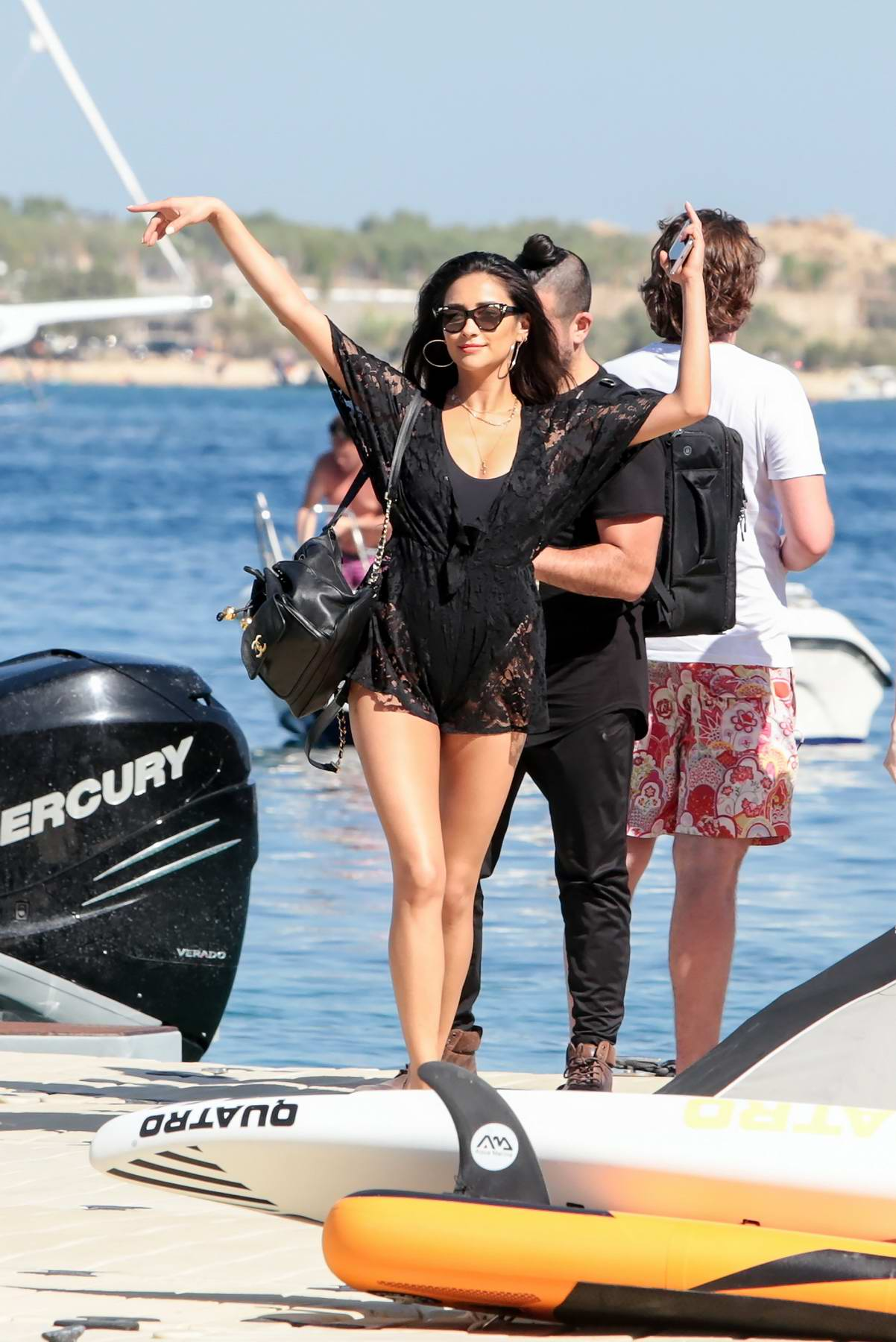 Shay Mitchell in a Black Swimsuit enjoying herself before leaves on a Boat in Mykonos, Greece