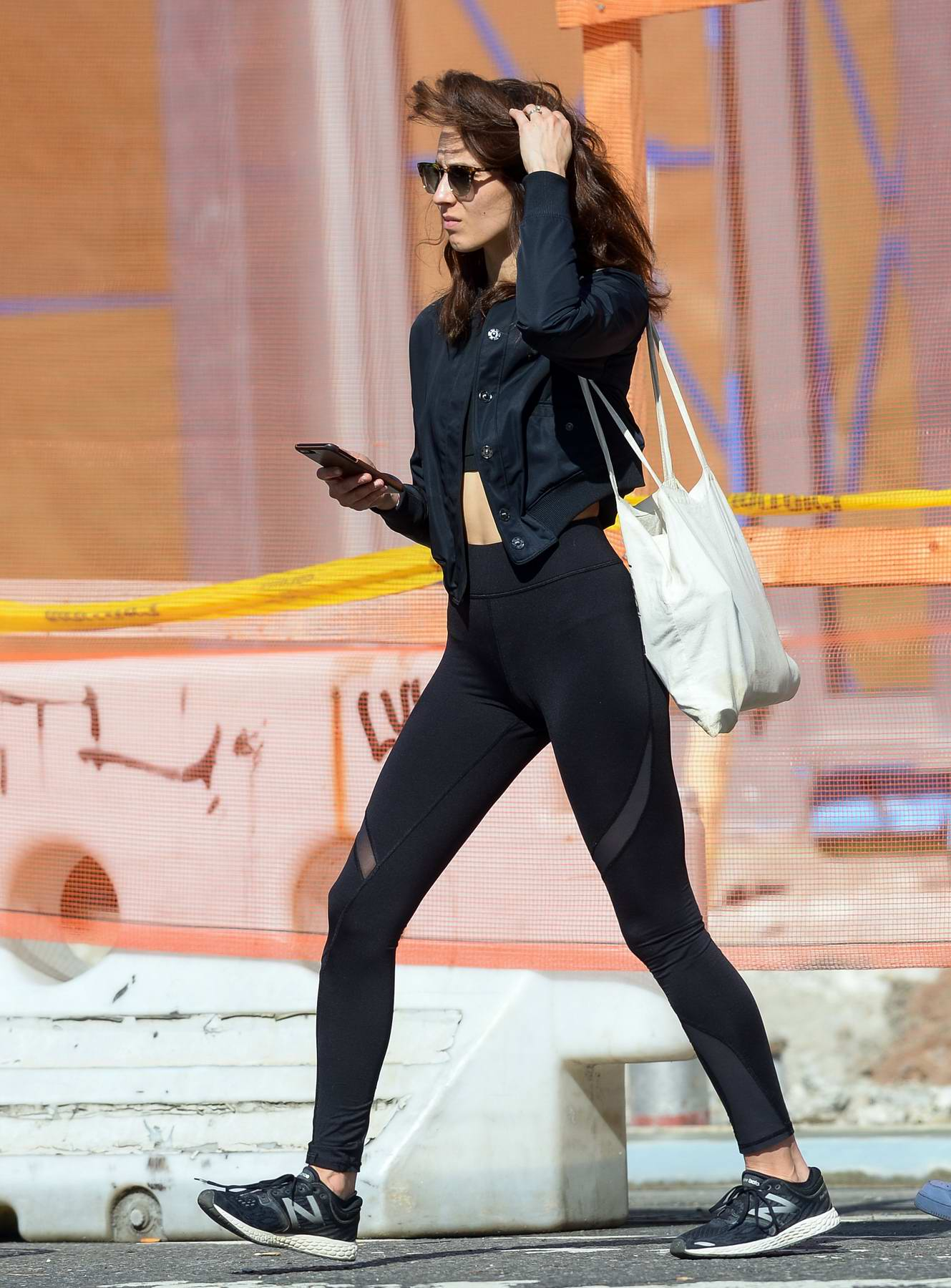 Trojan Bellisario spotted in her Gym Gear on her way for a Workout in Downtown, New York