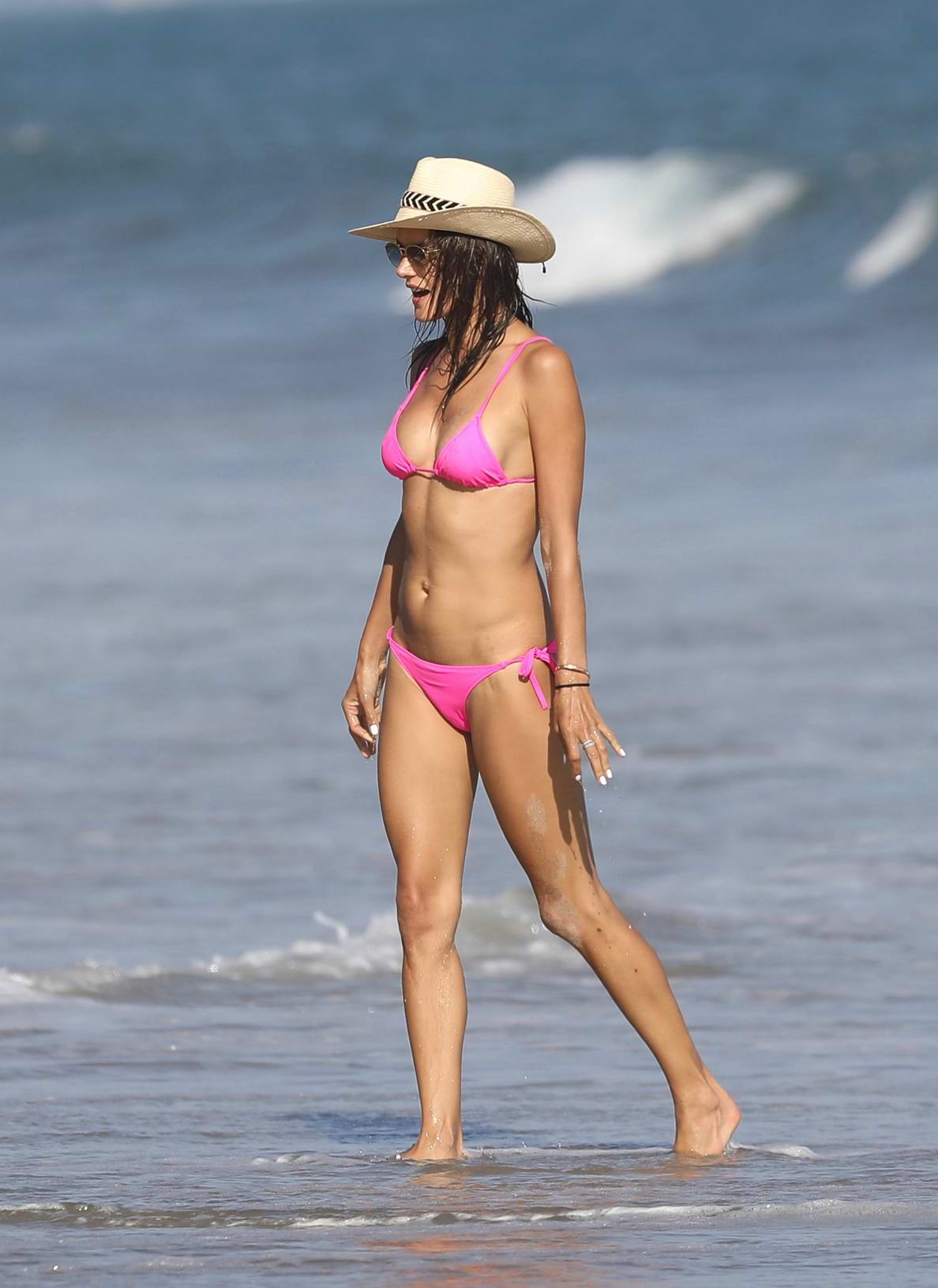 Alessandra Ambrosio in a Pink Bikini relaxing by the Beach in Malibu