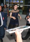 Alexandra Daddario greets fans outside ArcLight Theatre in Hollywood, Los Angeles