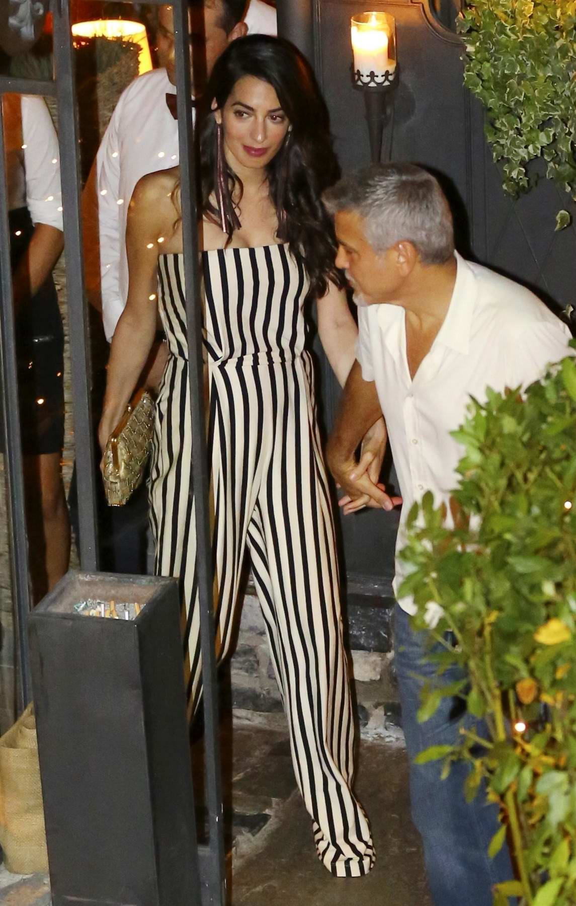 Amal Clooney and George Clooney enjoying a romantic dinner at Gatto Nero Restaurant in Lake Como, Italy