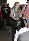 Amanda Seyfried and husband Thomas Sadoski along with their baby and dog arrive at LAX Airport in Los Angeles