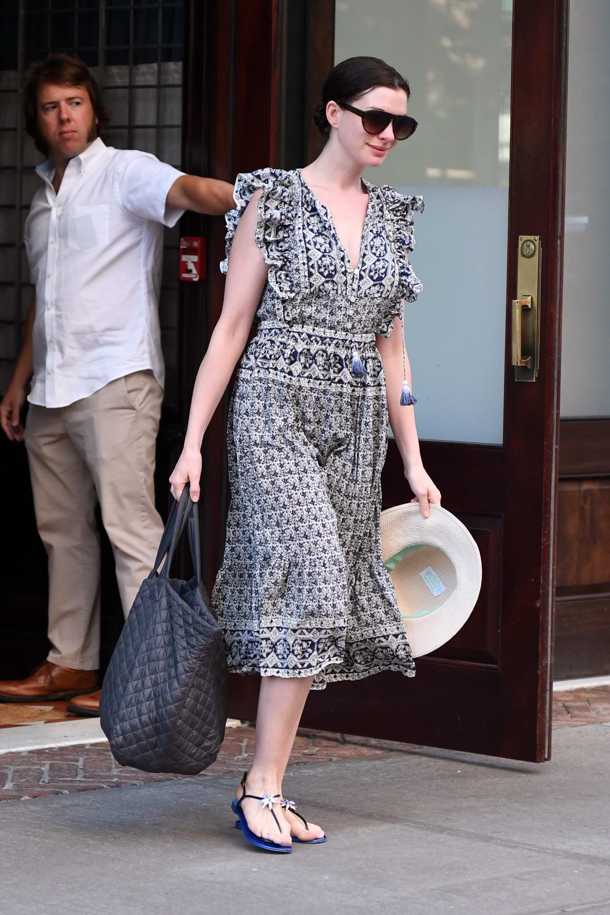 Anne Hathaway leaving her hotel while heading to a Photoshoot in New York
