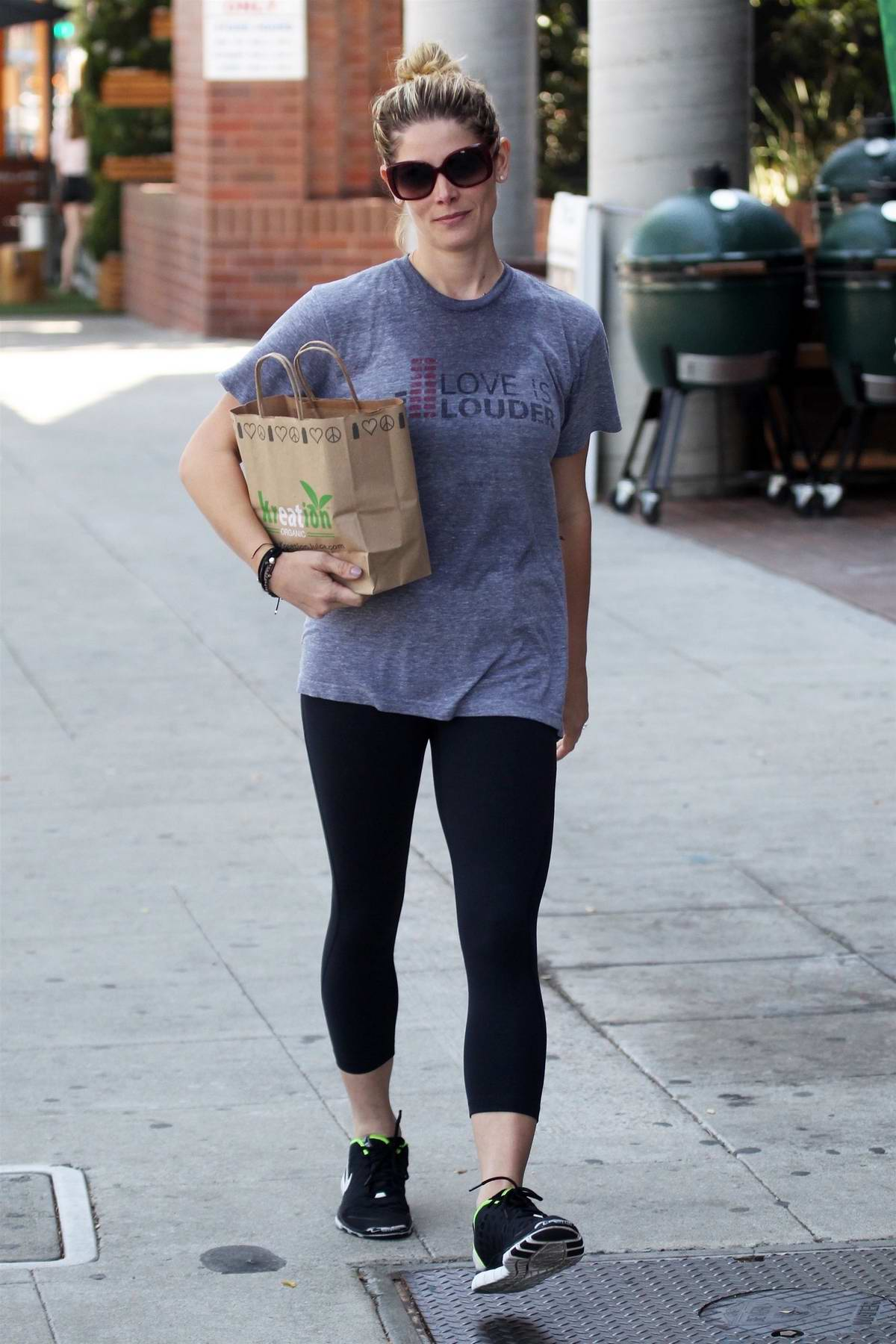 Ashley Greene stops to pick up some drinks at Kreation Organic Juicery after a workout session in West Hollywood