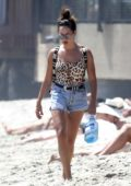 Ashley Tisdale in Leopard print swimsuit relaxing on the beach in Malibu