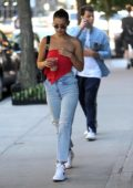 Bella Hadid in a Red Top and Jeans out with her Coffee in New York