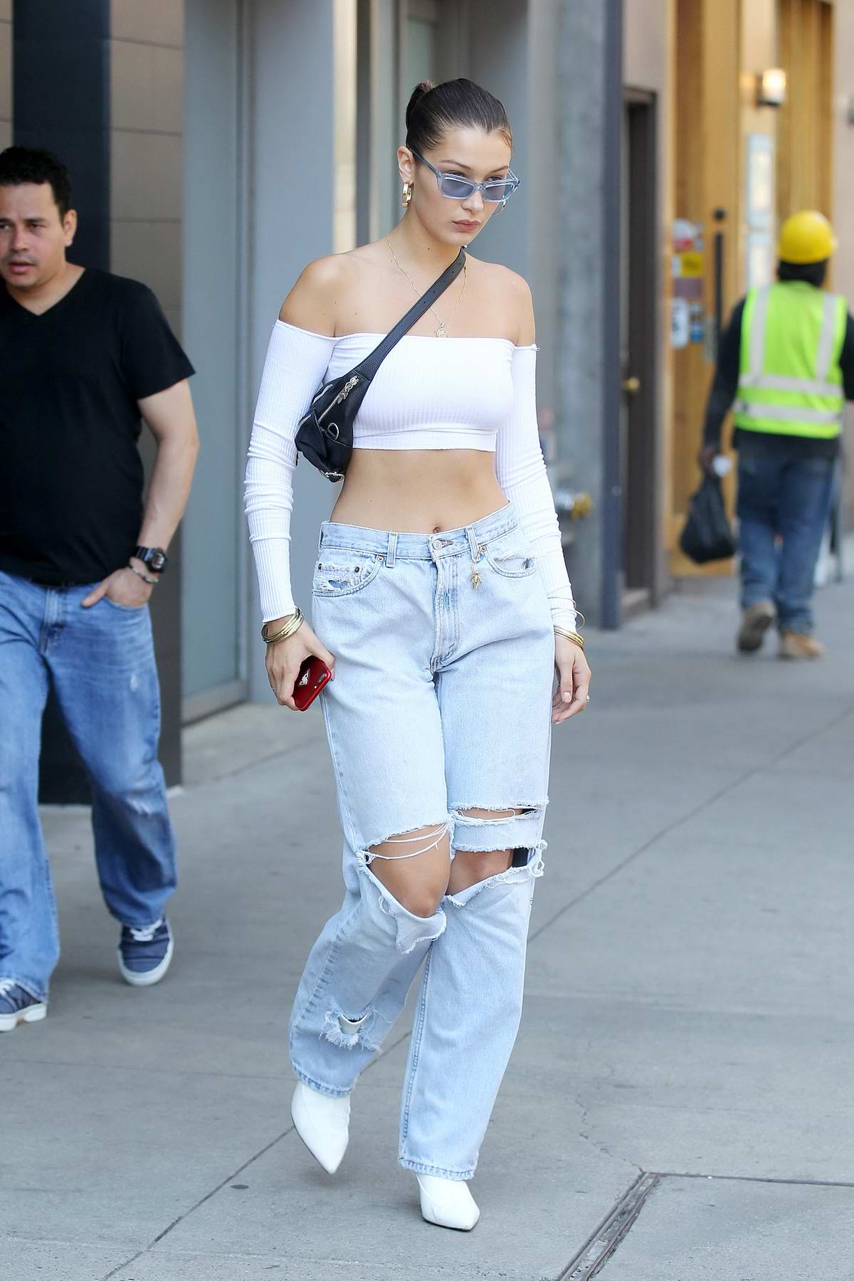 Bella Hadid rocking a White Top and Ripped Jeans while out in New York