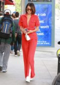 Bella Hadid rocks a red jumpsuit while out and about in New York