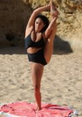 Casey Batchelor in a Black Bikini spotted doing some Yoga on a Beach in Portugal