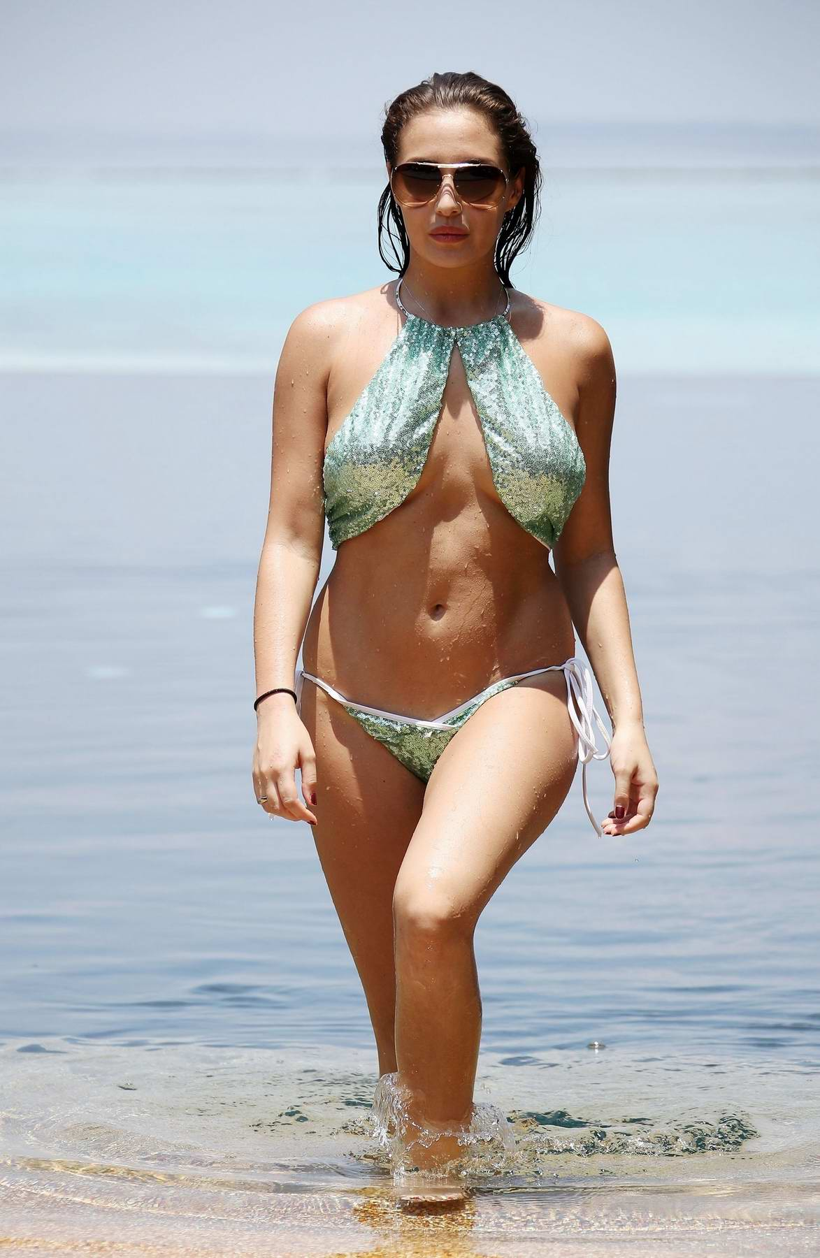 Chloe Goodman in a bikini enjoying herself on the beaches of Barbados